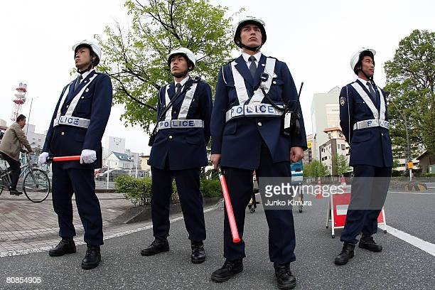 Police stand guard ahead of the Olympic tourch relay on April 25 2008 in Nagano prefecture Japan The start point of the torch relay was altered as...