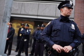 Police stand guard as demonstrators joined by members of the Occupied Wall Street Movment march near Baruch College in Manhattan to protest against...