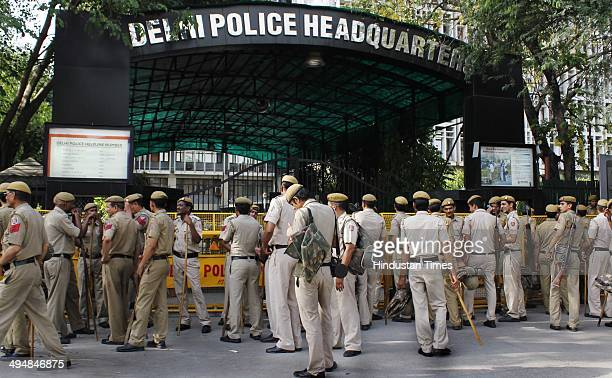 Police stand guard as parents and relatives of 19yearold Indian mariner Pradeep Sharma protest at ITO on May 31 2014 in New Delhi India Pradeep died...