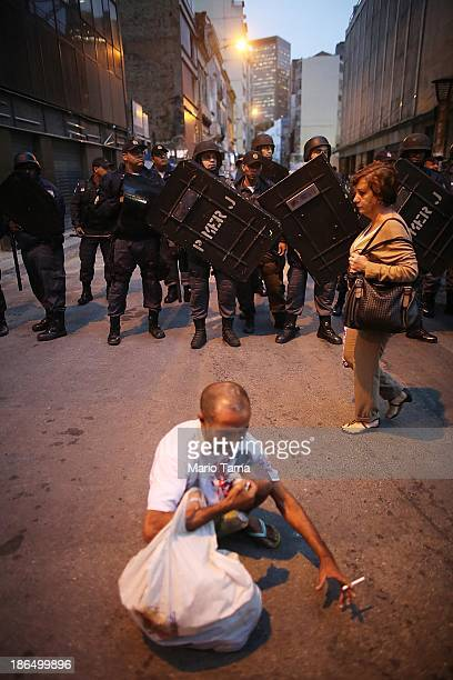 Police stand guard as people gather near antigovernment protesters marching on October 31 2013 in Rio de Janeiro Brazil Protesters called for an end...