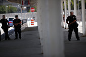 Police stand guard as people protest in Staten Island on the one year anniversary of the death of Eric Garner on July 17 2015 in New York City Garner...
