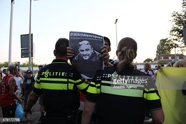 Police stand guard as protesters demonstrate in The Hague's Schilderswijk district the Netherlands on July 01 after Mitch Henriquez from Aruba died...