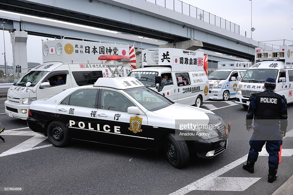 Police stand guard as tens of thousands of people gather to protest newly enforced security laws arguing that the security laws violate Japan's pacifist constitution and damage the Japanese people's right to peaceful survival on May 3, 2016 in Tokyo, Japan.