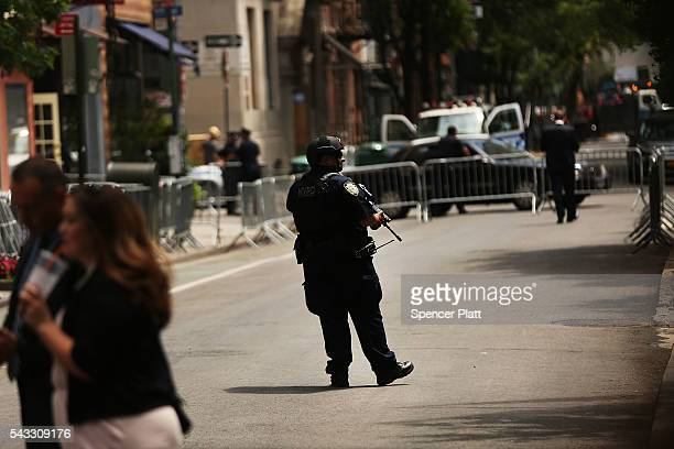 Police stand guard at a dedication ceremony officially designating the Stonewall Inn as a national monument to gay rights on June 27 2016 in New York...