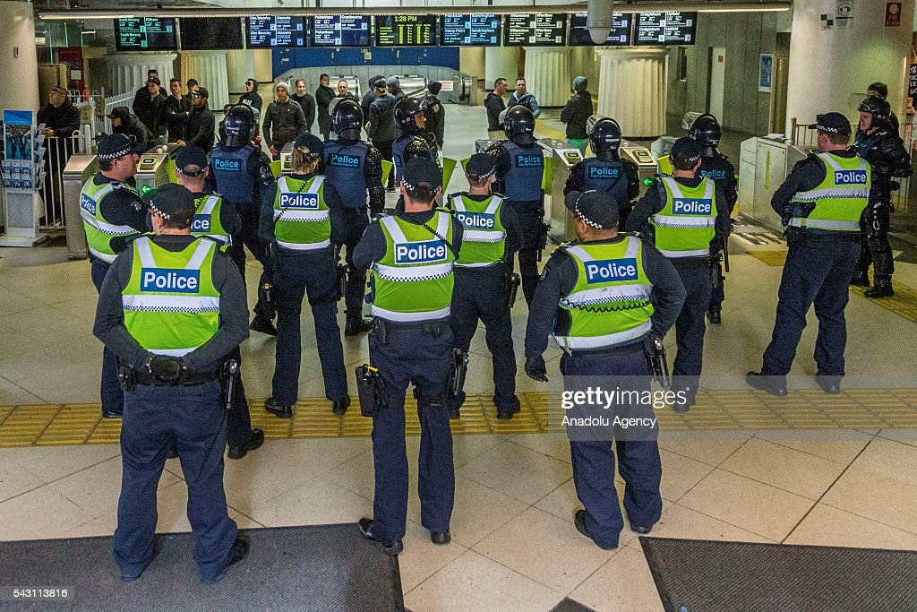 Police stand guard at a subway station to prevent further clashes during a protest organized by the anti-Islam True Blue Crew supported by the United Patriots Front in Melbourne, Australia on June 26, 2016.