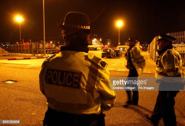 Police stand guard at Aberdeen harbour as they await a boat carrying bodies from the scene of a helicopter crash in the North Sea