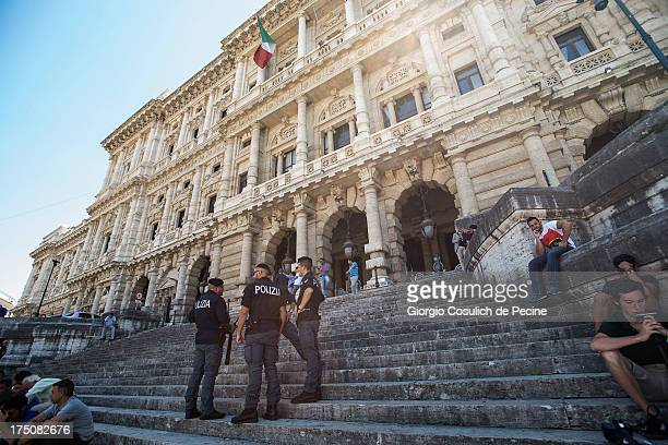 Police stand guard at the entrance of the 'Corte di Cassazione' or Supreme Court during the final arguments as former Italian Prime Minister Silvio...