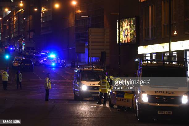 Police stand guard at the scene of a suspected terrorist attack during a pop concert by US star Ariana Grande in Manchester northwest England on May...
