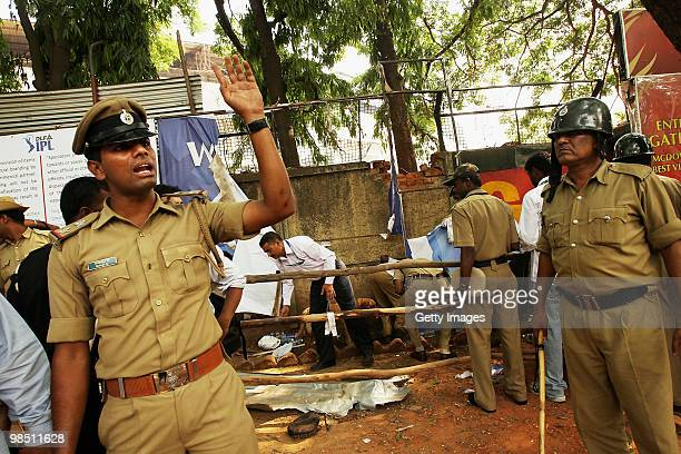 Police stand guard at the site of a low intensity blast at the gate prior to the start of the 2010 DLF Indian Premier League T20 group stage match...