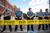 Police stand guard during a rally for Michael Brown outside the Ferguson Police Department August 30 2014 in Ferguson Missouri Michael Brown an...