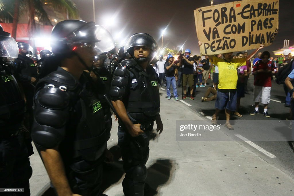 Police stand guard during an anti-World Cup demonstration in the Copacabana section on June 12, 2014 in Rio de Janeiro, Brazil. This is the first day of World Cup play.