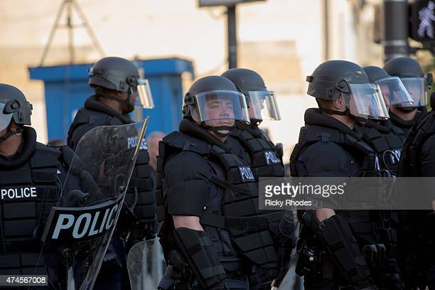 Police stand guard during demonstrations in reaction to Cleveland police officer Michael Brelo being acquitted of manslaughter charges after he shot...
