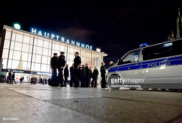 Police stand guard in front of Hauptbahnhof main railway station after an Pegida Hogesa and other rightwing populist groups gather to protest against...