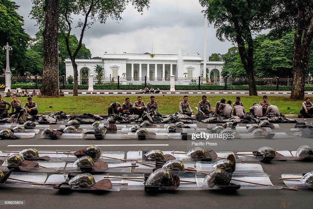 Police stand guard in front of State Palace when teachers hold rallies in Jakarta, Indonesia.