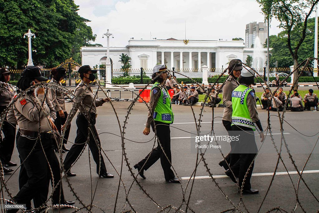 Police stand guard in front of State Palace when teachers hold rallies. Jakarta, Indonesia.