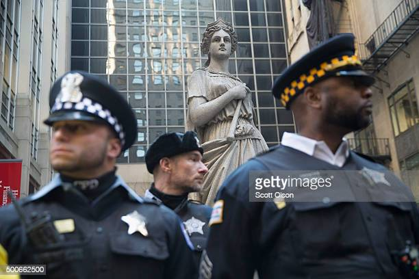 Police stand guard in front of the Chicago Board of Trade building during a demonstration on December 9 2015 in Chicago Illinois About 1000...