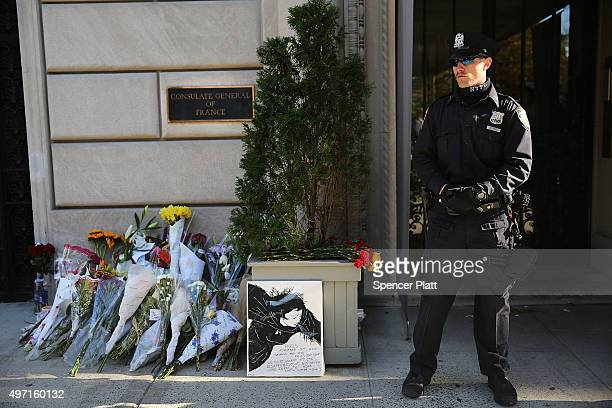 Police stand guard in front of the Consulate General of France in New York the day after an attack on civilians in Paris on November 14 2015 in New...