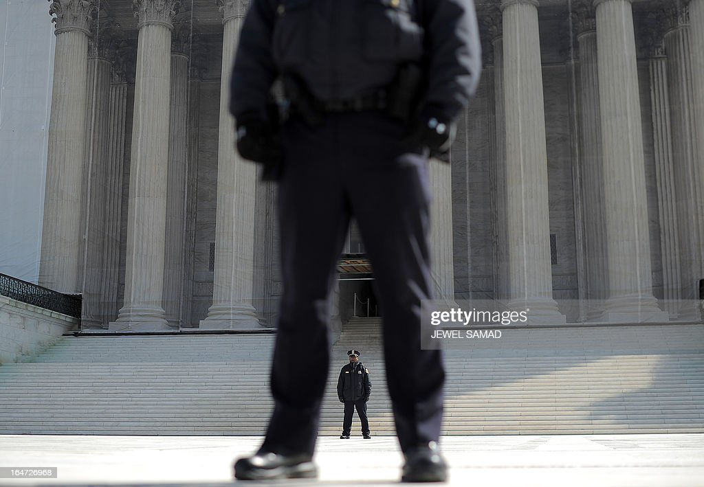 Police stand guard in front of the Supreme Court on March 27, 2013 in Washington, DC. The US Supreme Court tackled same-sex unions for a second day Wednesday, hearing arguments for and against the 1996 US law defining marriage as between one man and one woman. After the nine justices mulled arguments on a California law outlawing gay marriage on Tuesday, they took up a challenge to the constitutionality of the federal Defense of Marriage Act (DOMA). The 1996 law prevents couples who have tied the knot in nine states -- where same-sex marriage is legal -- from enjoying the same federal rights as heterosexual couples. AFP PHOTO/Jewel Samad