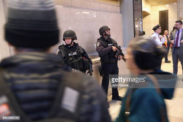 Police stand guard in Grand Central terminal in Midtown Manhattan after a pipe bomb explosion on December 11 2017 in New York City Police said that...