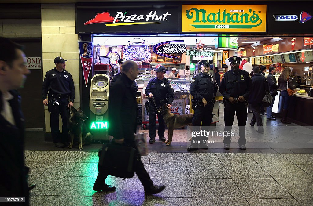 Police stand guard inside Penn Station on April 16, 2013 in New York City. Police were out in force throughout New York, a day after explosions near the finish line of the Boston Marathon killed 3 people and wounded more than 170 others.