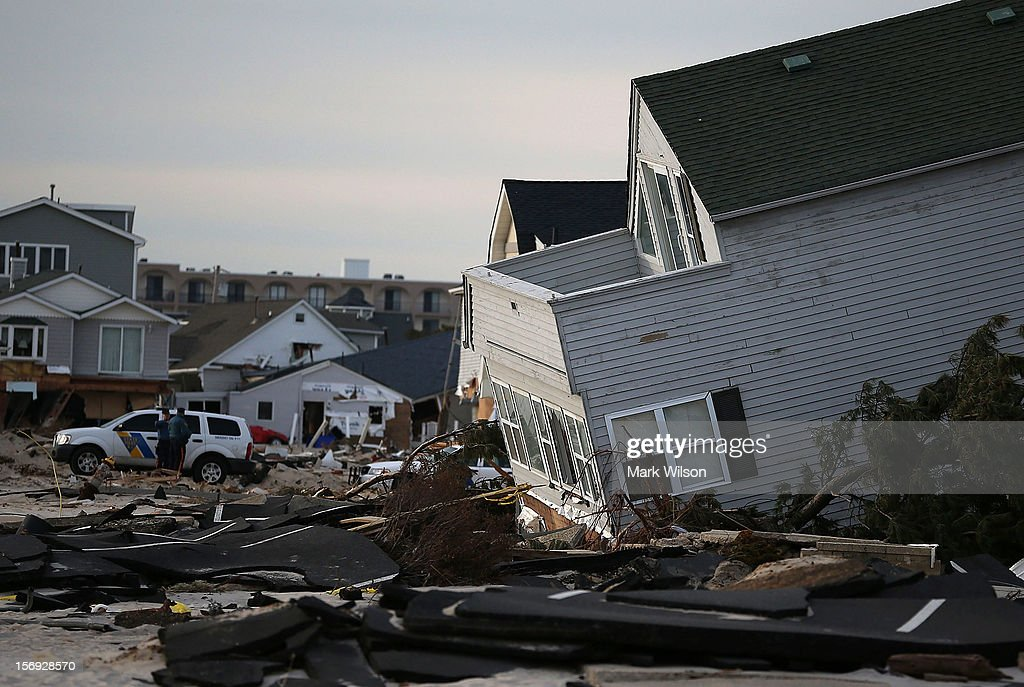 Police stand guard near beach homes that were damaged by Superstorm Sandy on November 25, 2012 in Ortley Beach, New Jersey. New Jersey Gov. Christie estimated that Superstorm Sandy cost New Jersey $29.4 billion in damage and economic losses.