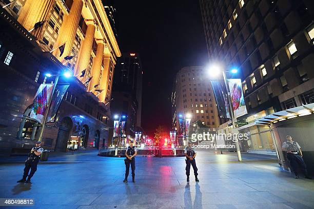 Police stand guard near the Lindt Chocolate Cafe in Martin Place following a hostage standoff on December 16 2014 in Sydney Australia Two were...