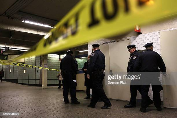 Police stand guard near where the body of an apparent suicide victim waits to be removed at a subway station in Times Square on January 22 2013 in...