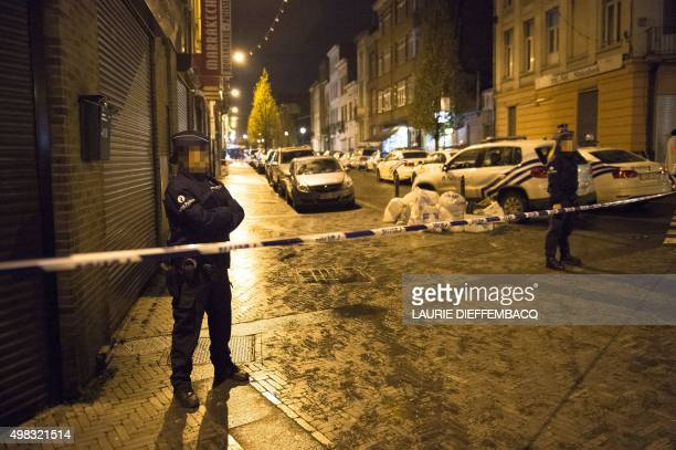 Police stand guard on a security perimeter as a reported police intervention takes place in Brussels on November 22 2015 Brussels will remain at the...
