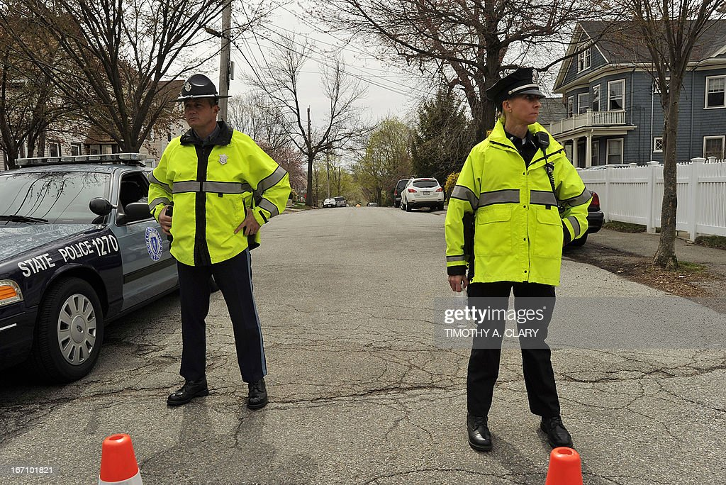 Police stand guard on April 20, 2013 at the street leading to the house where Dzhokhar Tsarnaev was hiding and captured in Watertown, Massachusetts. Thousands of heavily armed police staged an intense manhunt April 29 for the Chechen teenager suspected in the Boston marathon bombings with his brother, who was killed in a shootout. Dzhokhar Tsarnaev, 19, defied the massive force after his 26-year-old brother Tamerlan was shot and suffered critical injuries from explosives believed to have been strapped to his body.