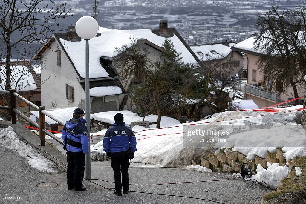 Police stand guard on January 3, 2013 in Daillon, southern Switzerland, next to the house of a gunman with known psychiatric and drug problems who opened fire the day before on the streets of the small village, killing three women and injuring two men. The 33-year-old gunman was wounded during an exchange of gunfire while being apprehended by police and also taken to a hospital. Officials said the man, whom police did not identify, had spent time in a psychiatric hospital in 2005 and was known to police as a drug user. Police had previously confiscated weapons when he was placed in a psychiatric ward.