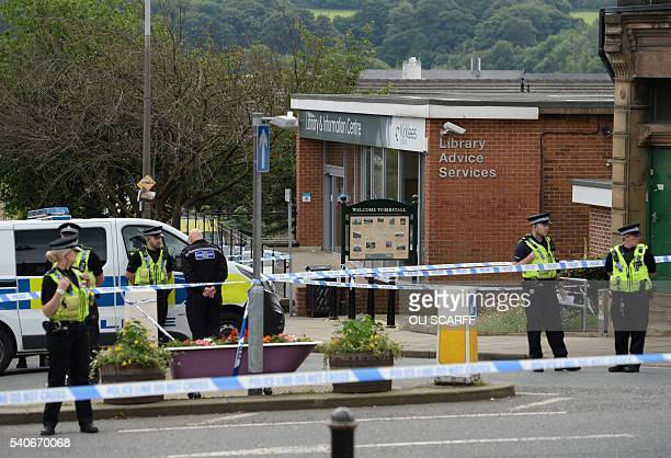 Police stand guard on the perimeter of the crime scene outside the library in Birstall where Labour MP Jo Cox was shot on June 16 2016 Campaigning...