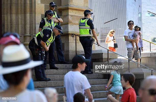 Police stand guard outside St Paul's Cathedral in Melbourne as people arrive for a Christmas service on December 25 2016 A 'significant' Islamic...