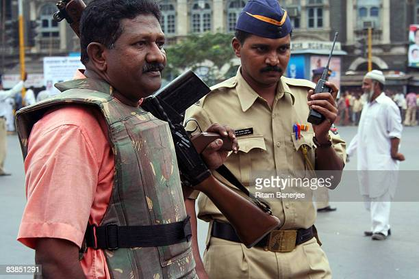 Police stand guard outside the Chatrapati Shivaji Terminus on November 28 2008 in Mumbai India Following terrorist attacks on three locations in the...