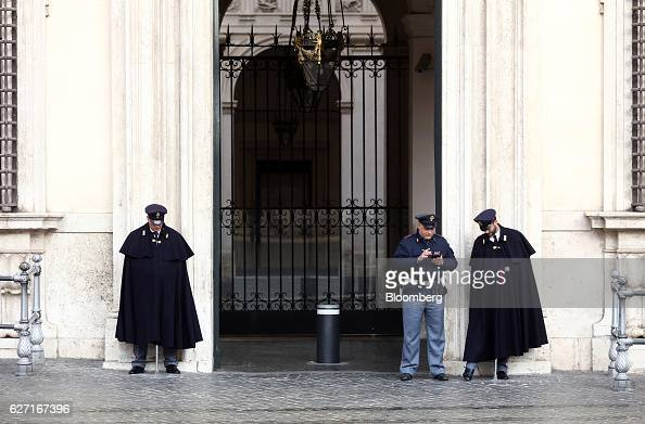 Police stand guard outside the entrance to the Palazzo Chigi on the final day of campaigning for the referendum on constitutional reform in Rome...