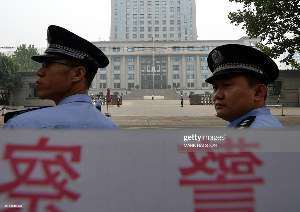 Police stand guard outside the Intermediate People's Court after disgraced politician Bo Xilai arrived for his sentencing in Jinan, Shandong Province on September 22, 2013. The verdict in the case of China's fallen political star Bo Xilai, will cap an extraordinary scandal involving bribes, murder, illicit love, political infighting, and a colourful yet tightly controlled trial. AFP PHOTO/Mark RALSTON