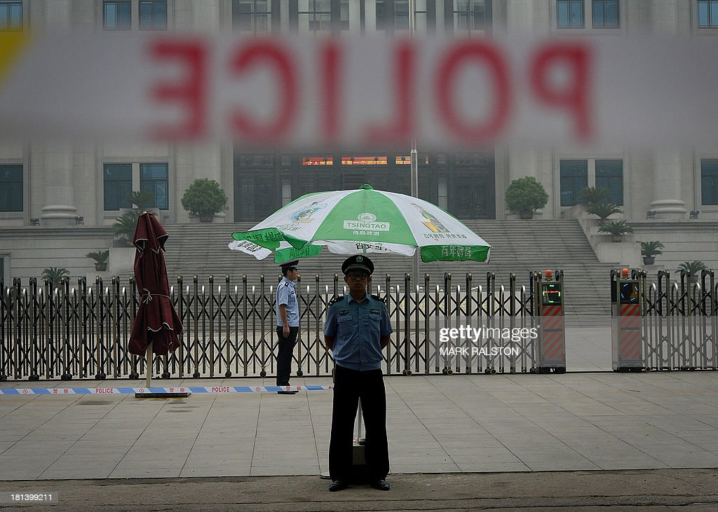 Police stand guard outside the Intermediate People's Court on the eve of the sentencing of disgraced politician Bo Xilai in Jinan, Shandong Province on September 21, 2013. The verdict in the case of China's fallen political star Bo Xilai, due on September 22, will cap an extraordinary scandal involving bribes, murder, illicit love, political infighting, and a colourful yet tightly controlled trial. Even before the stunning five-day hearing last month, the downfall of the once-powerful Bo was already the most sensational drama in decades to rock the ruling Communist Party and its prized stability. AFP PHOTO / Mark RALSTON