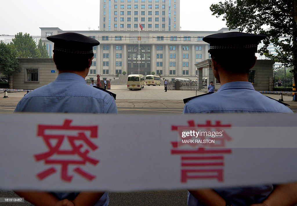 Police stand guard outside the Intermediate People's Court where disgraced politician Bo Xilai was sentenced to life in prison when his verdict was announced in Jinan, Shandong Province on September 22, 2013. Fallen Chinese political star Bo Xilai was sentenced by a court to life in prison, following a sensational scandal that culminated in the country's highest-profile trial in decades. AFP PHOTO/Mark RALSTON