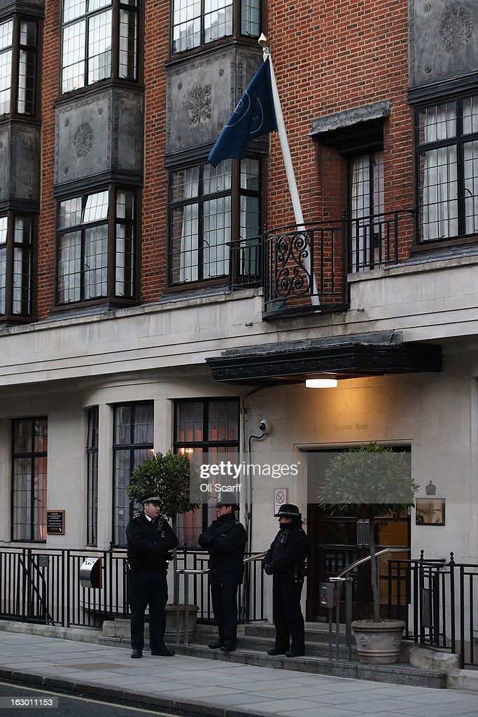 Police stand guard outside the King Edward VII Hospital where Queen Elizabeth II has been admitted after suffering from symptoms of gastroenteritis on March 3, 2013 in London, England. The 86-year-old monarch is expected to remain in hospital for two days and has cancelled or postponed all official engagements this week, including her trip to Rome.