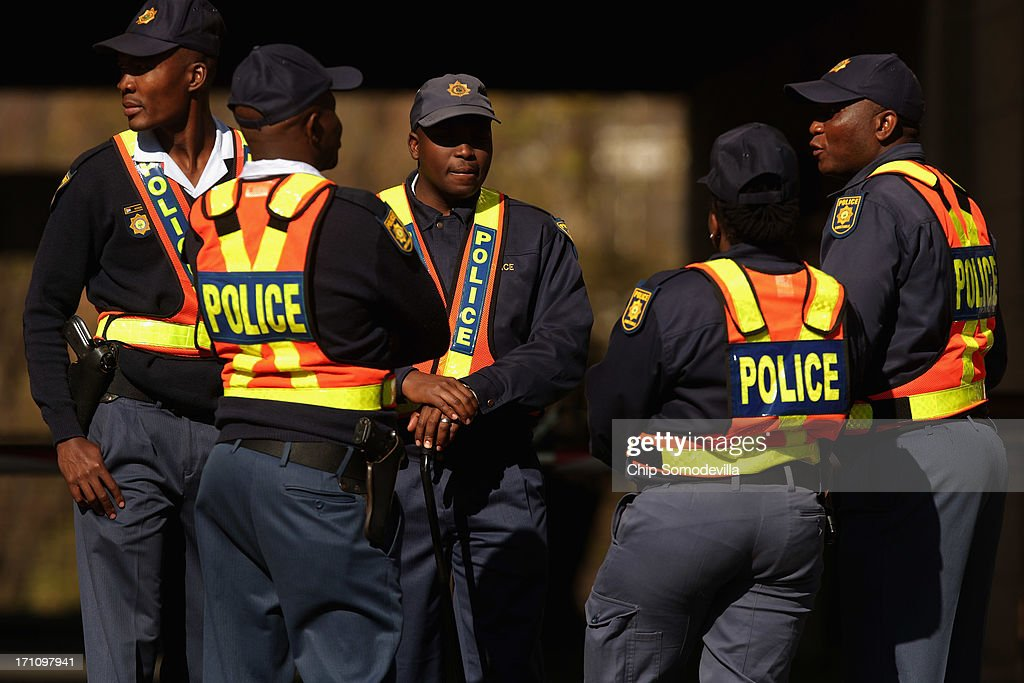 Police stand guard outside the Mediclinic Heart Hospital where former South African President Nelson Mandela, 94, is being treated for a recurring lung infection June 22, 2013 in Pretoria, South Africa. The Nobel Peace Prize laurete and anti-aparteid icon has been in hospital for two weeks in 'serious but stable' condition, according to the South African government.