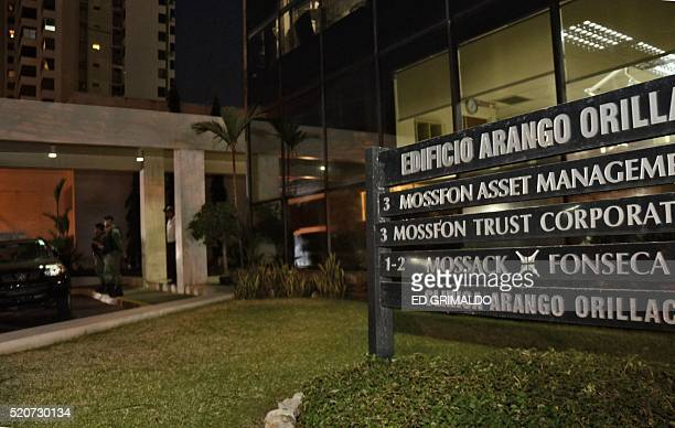 Police stand guard outside the Mossack Fonseca law firm offices in Panama City during a raid on April 12 2016 Police on Tuesday raided the...