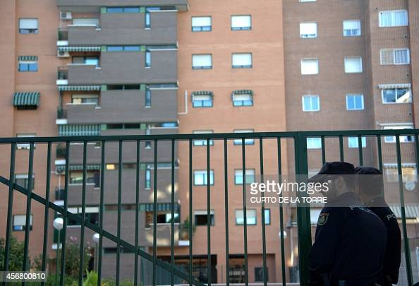 Police stand guard outside the residence of Teresa on October 7 2014 in Alcorcon a Spanish nurse after she was admited overnight to a Madrid hospital...