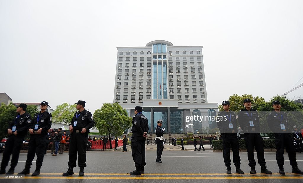 Police stand guard outside the Xianning Intermediate People's Court where Chinese mining tycoon Liu Han stands trial in Xianning, central China's Hubei province on March 31, 2014. Liu Han, who once mounted a billion-dollar bid for an Australian company, went on trial for murder with 35 other alleged gang members, state media reported. The gang, based in Sichuan province in the southwest, are the biggest such 'mafia-style' group to face a courtroom in recent years, Xinhua said. CHINA
