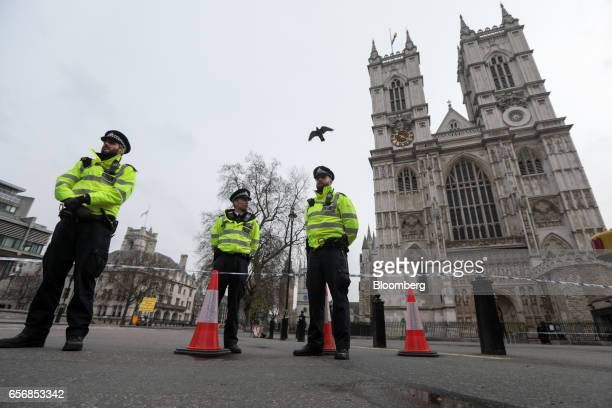 Police stand guard outside Westminster Abbey after the terror attack at Westminster in London UK on Thursday March 23 2017 Parliament will return to...