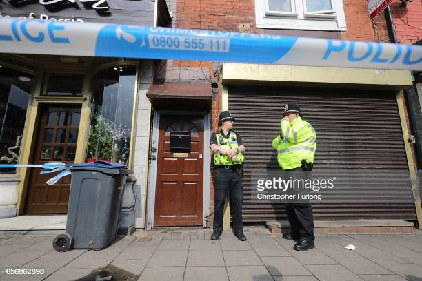 Police stand guard the entrance to a flat above Shiraz Restaurant in Hagley Road Birmingham which was raided by antiterror police in connection with...