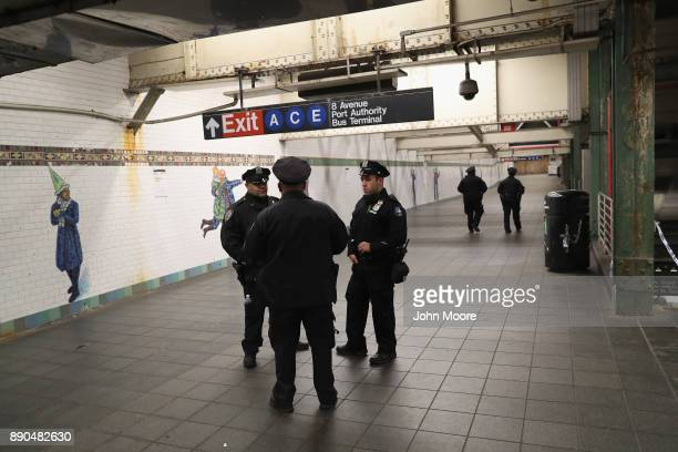 Police stand in a closedoff underground walkway near the site of a pipe bomb explosion on December 11 2017 in New York City Police said that Akayed...