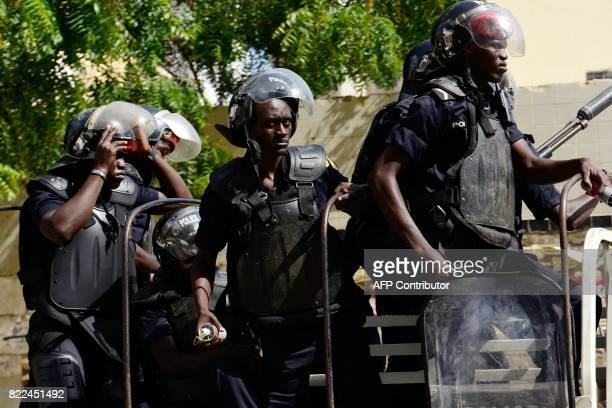 Police stand in a truck near Independence Square in Dakar on July 25 2017 as they disperse supporters of the former Senegalese president gathered for...