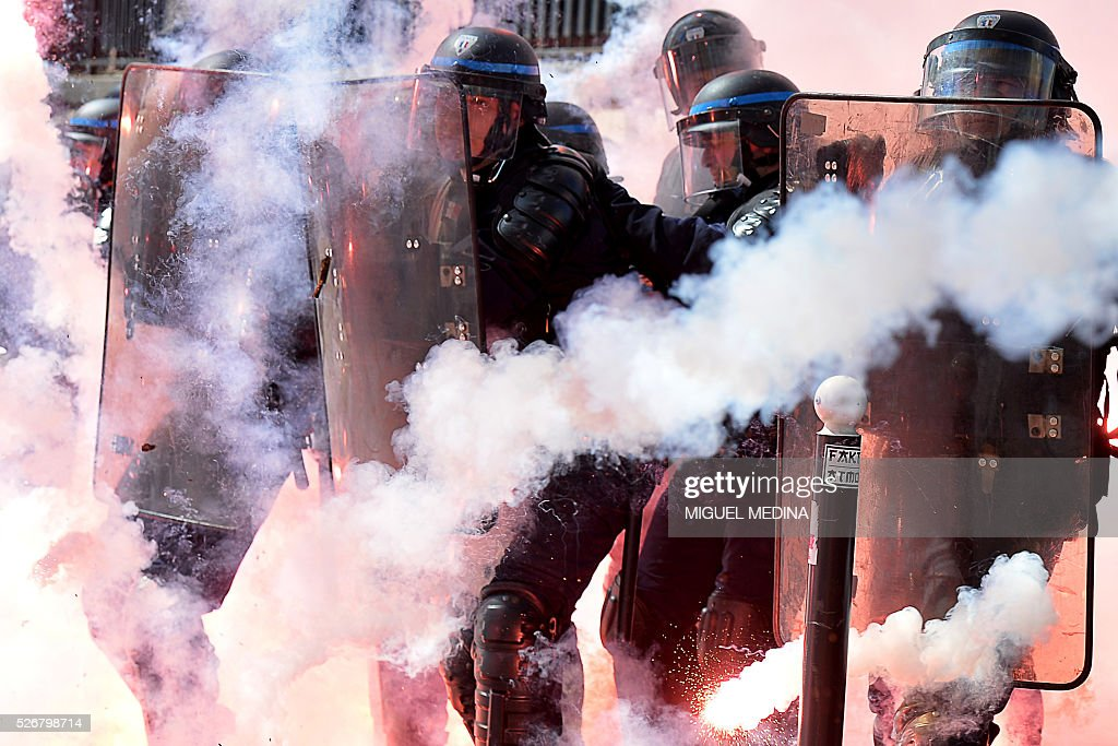Police stand in formation as they clash with protesters at a traditional May Day demonstration on May 1, 2016, in Paris.