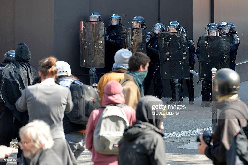 Police stand in formation as they face protesters at a traditional May Day demonstration on May 1, 2016, in Paris.