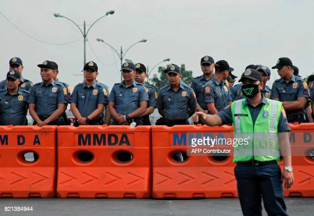 Police stand in formation as they secure the perimeter near the House of Representatives where Philippine President Rodrigo Duterte was expected to...