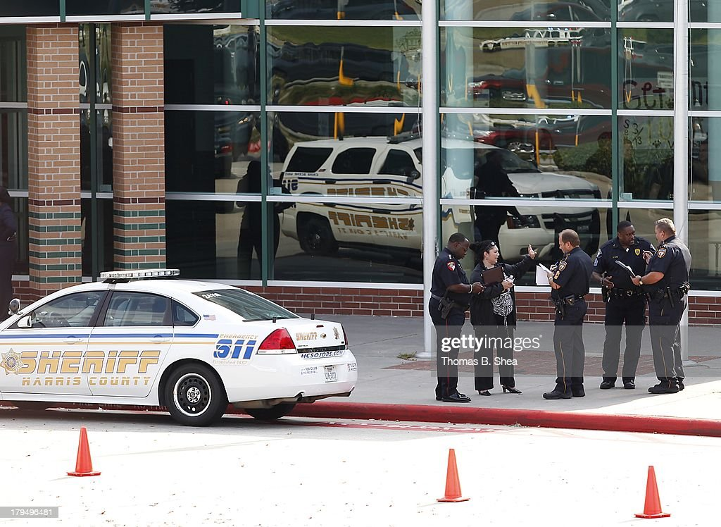 Police stand in front of Spring High School after a stabbing September 4, 2013 in Spring, Texas. A 17-year-old student was fatally stabbed and three other students during what has been reported as a fight at the school about 7:00 am. Three people have been taken into custody.